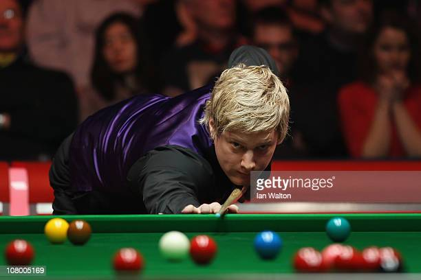 Neil Robertson of Australia plays a shot against Stephen Hendry of Scotland in Round One of The Ladbrokesmobile Masters on Day 4 at Wembley Arena on...