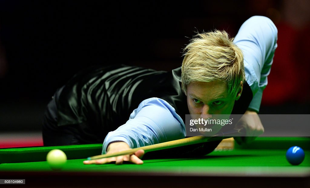 Neil Robertson of Australia plays a shot during his quarter final match against Judd Trump of England during Day Six of The Dafabet Masters at Alexandra Palace on January 15, 2016 in London, England.