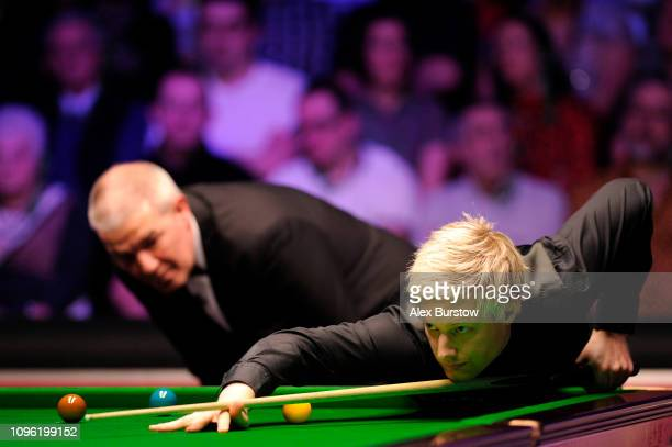 Neil Robertson of Australia plays a shot during his quarterfinal match against Barry Hawkins of England on day six of the 2019 Dafabet Masters at...