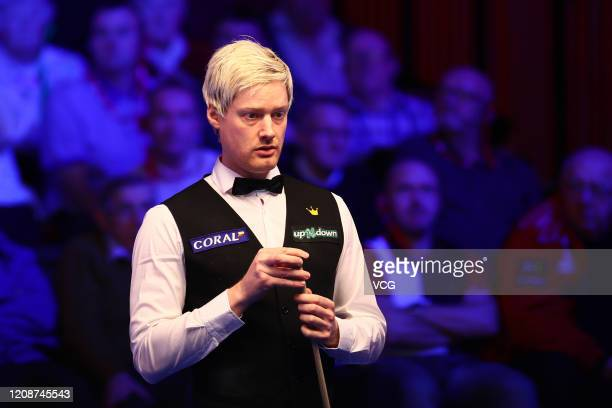 Neil Robertson of Australia plays a shot during the 1st round match against Joe Perry of England on day two of 2020 Coral Players Championship at...