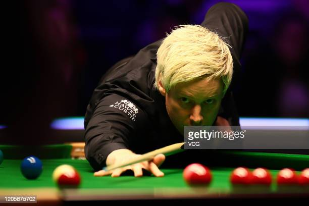 Neil Robertson of Australia plays a shot during the 2nd round match against Mark Joyce of England on day three of the 2020 ManBetX Welsh Open at the...