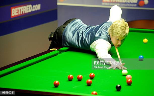 Neil Robertson of Australia plays a shot during the Betfredcom World Snooker Championships at the Crucible Theatre on April 21 2010 in Sheffield...