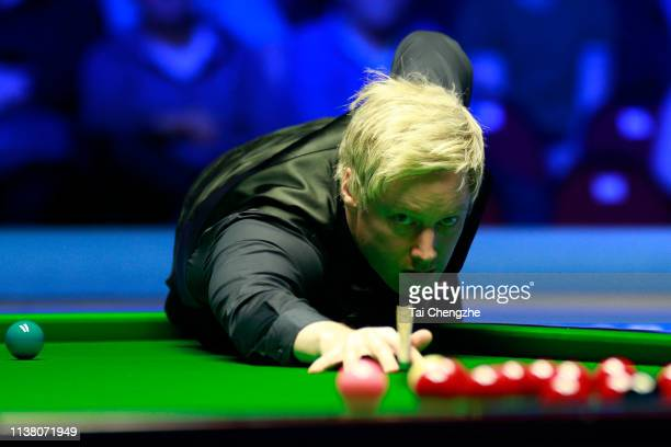 Neil Robertson of Australia plays a shot during the final match against Ronnie O'Sullivan of England on day six of 2019 Coral Tour Championship at...