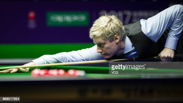 Neil Robertson of Australia plays a shot during the first round match against Gary Wilson of England on Day one of the 2017 World Snooker...