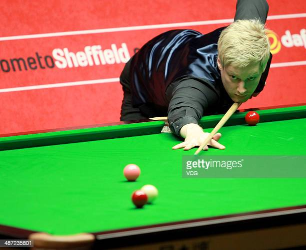 Neil Robertson of Australia plays a shot during the match against Mark Allen of Northern Ireland on Day ten of the Dafabet World Snooker Championship...