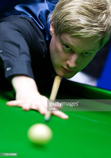 Neil Robertson of Australia plays a shot during the quarterfinal match against Joe Perry of England on day four of the World Snooker Australia Open...