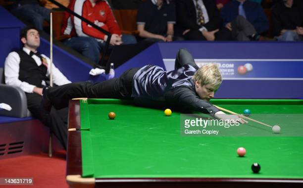 Neil Robertson of Australia plays a shot in his quarter final match against Ronnie O'Sullivan of England during the Betfredcom World Snooker...