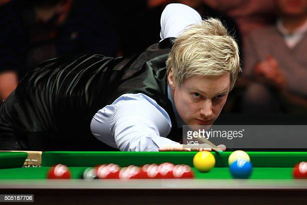 Neil Robertson of Australia plays a shot in his quarterfinal match against Judd Trump of England during day six of The Dafabet Masters 2016 at...