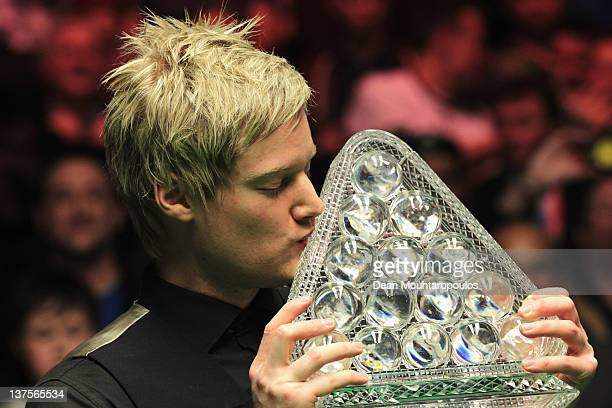 Neil Robertson of Australia poses with the trophy after vitory over Shaun Murphy of England in the The Final on day 8 of The Masters at Alexandra...