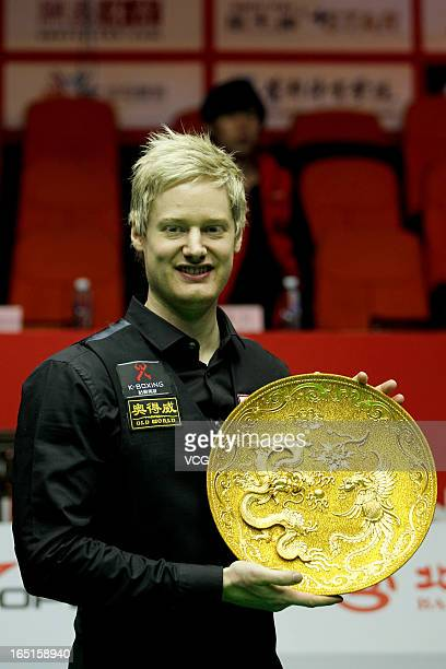 Neil Robertson of Australia poses with the trophy after winning the final match against Mark Selby of England during day seven of the 2013 World...