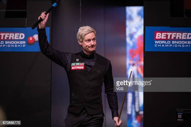 Neil Robertson of Australia reacts during his first round match against Noppon Saengkham of Thailand on day six of Betfred World Championship 2017 at...