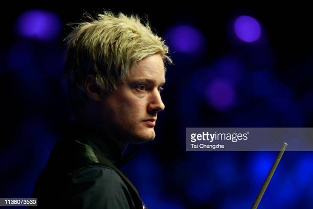 Neil Robertson of Australia reacts during the final match against Ronnie O'Sullivan of England on day six of 2019 Coral Tour Championship at Venue...