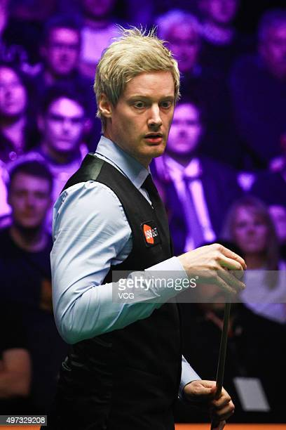 Neil Robertson of Australia reacts in final match against Mark Allen of Northern Ireland on day six of Champion of Champions 2015 at Ricoh Arena on...