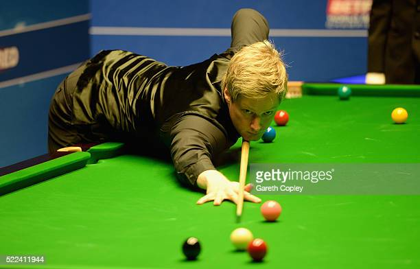 Neil Robertson plays a shot against Michael Holt during their first round match of the World Snooker Championship at Crucible Theatre on April 19...