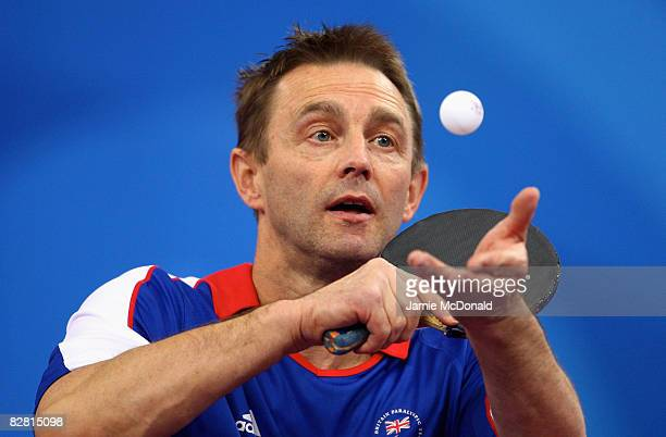 Neil Robinson of Great Britain serves in his match against Panfeng Feng of China in the Bronze Medal match in the Team Class 3 at the Peking...
