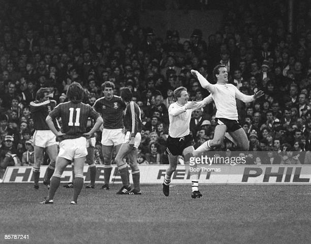 Neil Robinson of Swansea City rushes to congratulate teammate Alan Curtis after he scored the first goal after five minutes of a First Division match...