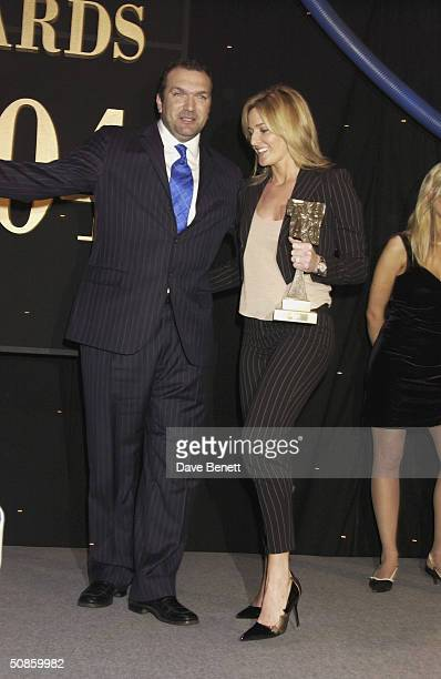 Neil Ruddock and Gabby Logan attend the 2004 Tric Awards at The Grovesnor House Hotel on March 10 2004 in London