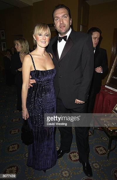 Neil Ruddock of the reality television show I'm A Celebrity Get Me Out Of Hereand his wife arrive at The Chocolate Ball March 11 2004 at Cafe Royal...