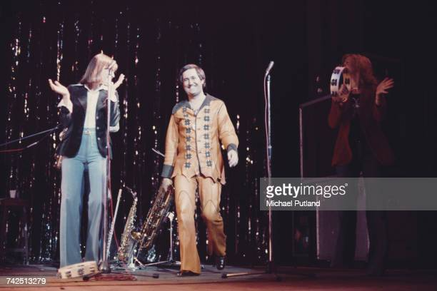Neil Sedaka American pianist and singersongwriter walks on to the stage to greet the audience during a live concert performance at the New Victoria...