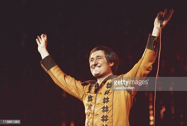Neil Sedaka US pianist and singersongwriter holding his hands in the air to greet the audience during a live concert performance at the New Victoria...
