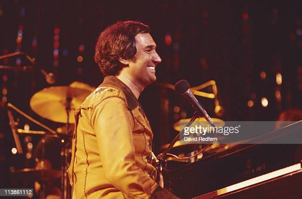 Neil Sedaka US pianist and singersongwriter sitting at a piano during a live concert performance at the New Victoria Theatre in London England Great...