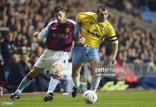 Neil Shipperley of Crystal Palace is tackled by Gareth Barry of Aston Villa during the Carling Cup fourth round match between Aston Villa and Crystal...