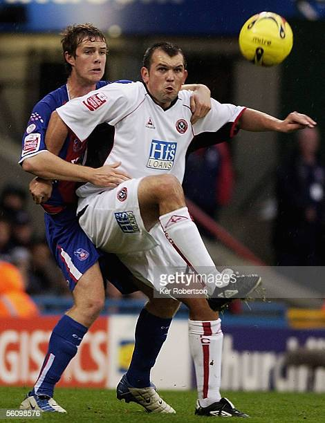 Neil Shipperley of Sheffield United holds off Gary Borrowdale of Crystal Palace during the CocaCola Championship match between Crystal Palace and...