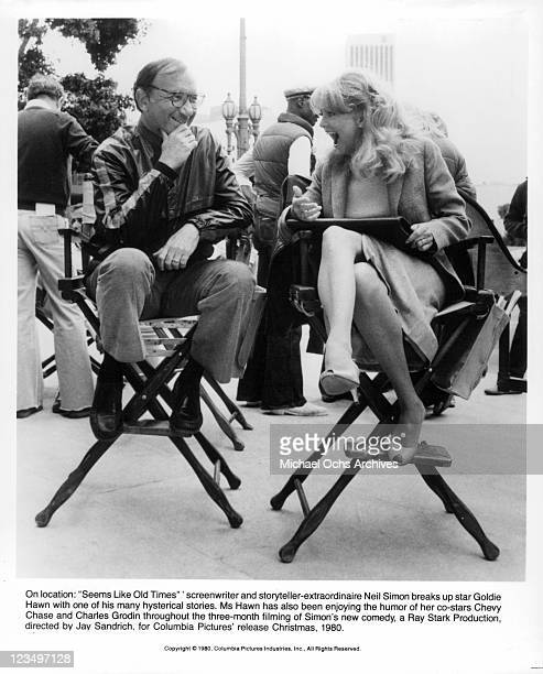 Neil Simon sits with Goldie Hawn as she laughs at his jokes in a scene from the film 'Seems Like Old Times' 1980
