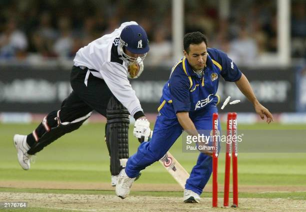 Neil Smith of Warwickshire Bears is run out by Adam Hollioake of Surrey Lions to end Warwickshire's innings during the final of the Twenty20 Cup...