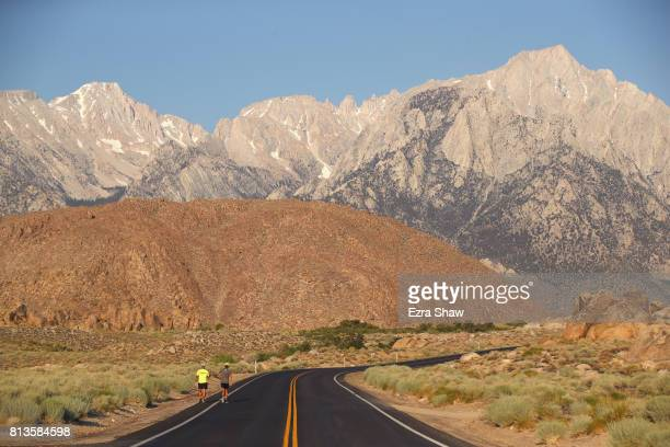 Neil Smith runs to the Whitney Portal with a member of his support crew during the STYR Labs Badwater 135 on July 12 2017 in Death Valley California...