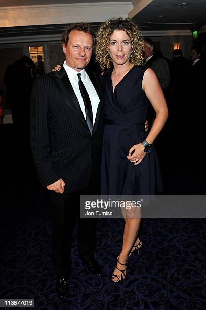 Neil Stuke and his wife Sally Ann Stuke attend The 2011 Sony Radio Academy Awards at The Grosvenor House Hotel on May 9 2011 in London England