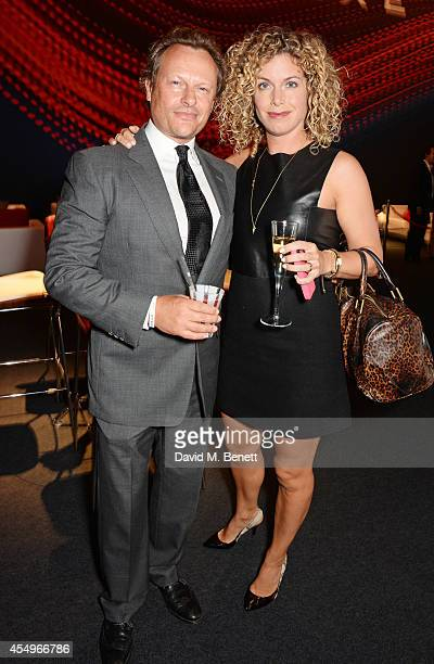 Neil Stuke and SallyAnn Stuke attend as guests of Jaguar at the global reveal of the new XE in London at Earls Court on September 8 2014 in London...