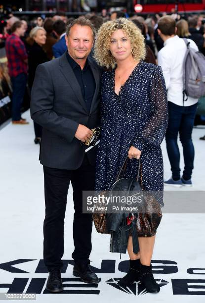 Neil Stuke and wife Sally Ann Stuke arriving for the King of Thieves World Premiere held at Vue West End Leicester Square London