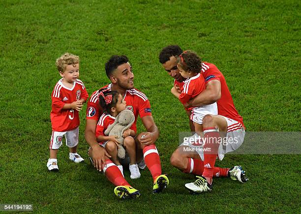 Neil Taylor and Hal RobsonKanu of Wales celebrate their team's 31 win with their children after the UEFA EURO 2016 quarter final match between Wales...