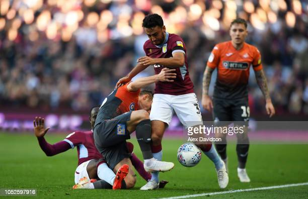 Neil Taylor of Aston Villa is tackled by Connor Roberts of Swansea City during the Sky Bet Championship match between Aston Villa and Swansea City at...