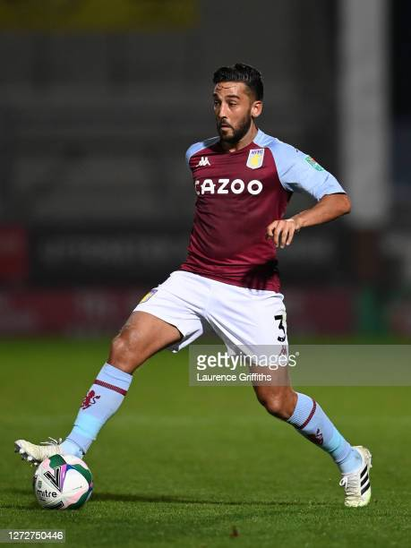 Neil Taylor of Aston Villa runs with the ball during the Carabao Cup Second Round match between Burton Albion and Aston Villa at Pirelli Stadium on...