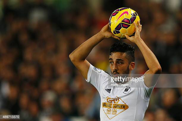 Neil Taylor of Swansea City takes a throw in during the Barclays Premier League match between Swansea City and Crystal Palace at Liberty Stadium on...