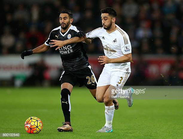 Neil Taylor of Swansea holds off pressure from Riyad Mahrez of Leicester during the Barclays Premier League match between Swansea City and Leicester...
