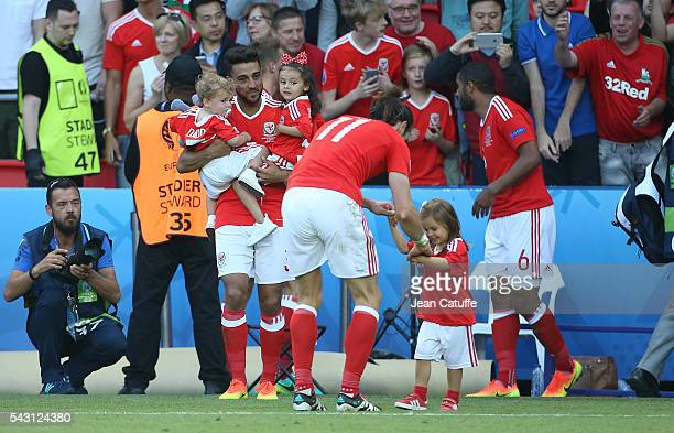 Neil Taylor of Wales with his children and Gareth Bale with his daughter Alba Bale celebrate the victory following the UEFA EURO 2016 round of 16...