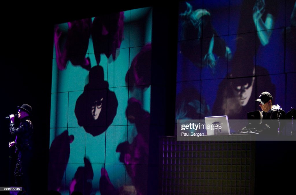 Neil tennant and chris lowe of pet shop boys perform on stage in pet shop boys meet fans at hmv store in amsterdam news photo m4hsunfo