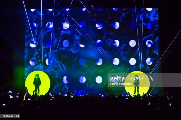 Neil Tennant and Chris Lowe of the British band Pet Shop Boys perform live on stage during a concert at the MercedesBenz Arena on July 1 2017 in...