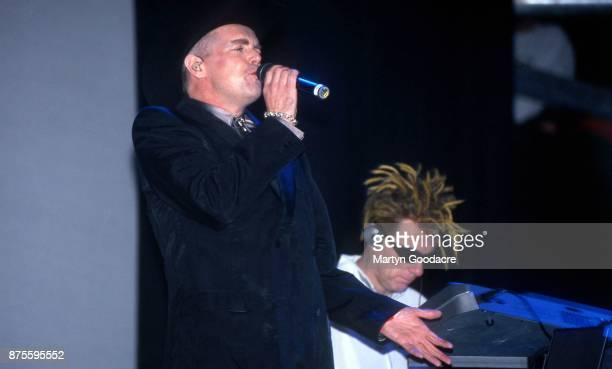 Neil Tennant and Chris Lowe of the Pet Shop Boys perform on stage at Glastonbury Festival 24th June 2000