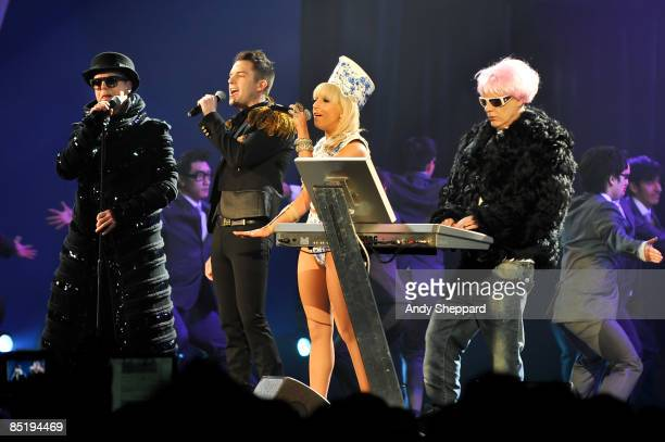 Neil Tennant and Chris Lowe of the Pet Shop Boys perform on stage with Brandon Flowers of the Killers and Lady Gaga at the 2009 Brit Awards held at...