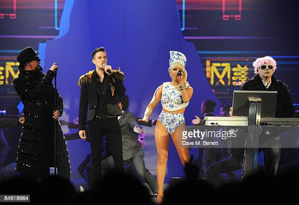 Neil Tennant and Chris Lowe of the Pet Shop Boys with Brandon Flowers and Lady GaGa perform on stage during The Brit Awards 2009 at Earls Court One...