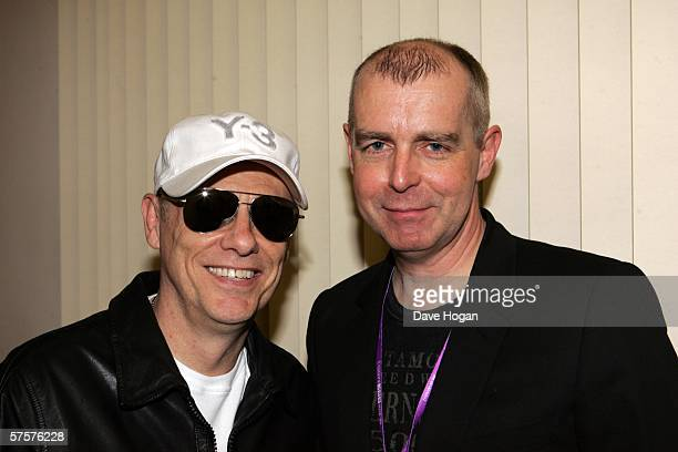 Neil Tennant and Chris Lowe pose backstage at the Radio 2 Pet Shop Boys secret gig at the Mermaid Theatre on May 8 2006 in London England The duo...