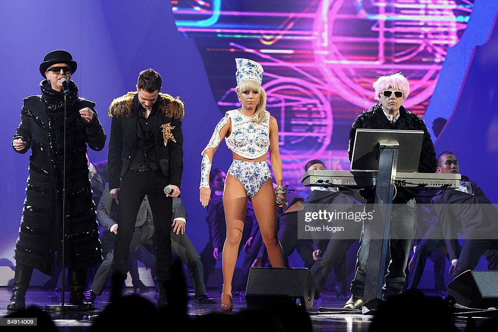 L-R Neil Tennant, Brandon Flowers, Lady Gaga and Chris Lowe perform at the Brit Awards 2009 held at Earls Court on February 18, 2009 in London, England.