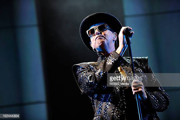 Neil Tennant of Pet Shop Boys performs on stage during the music festival at Worthy Farm on June 26 2010 in Glastonbury England