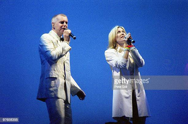 Neil Tennant of The Pet Shop Boys is joined on stage by Cerys Matthews at the Glastonbury Festival on June 24th 2000 in Glastonbury England