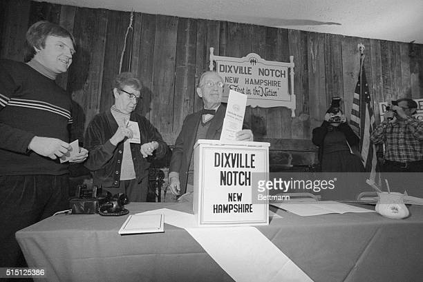Neil Tillotson Dixville Notch town moderator prepares to cast the first primary vote in the Nation as Mrs Cora Whitton Supervisor of the Checklist...