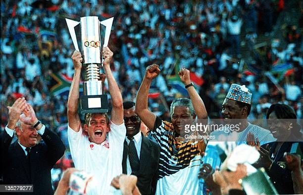 Neil Tovey of South Africa, captain of the winners of the African Cup of Nations Final celebrates with the trophy after President Nelson Mandela...